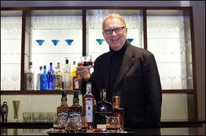 Robert Zollweg, creative director, holds a glass from the new collection at the Libbey showroom. 'Restaurateurs don't want to serve really good bourbon in an ordinary bar glass,' he says.