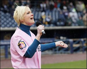 WTOL-TV,  Channel 11 news anchor  Chrys Peterson sings the national anthem prior to the start of the Mud Hens' home-opener April 11 at Fifth Third Field.