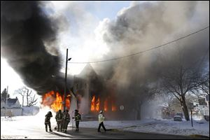 St. Mark Baptist Church on North Detroit Avenue at Fernwood Avenue is destroyed by fire Friday.