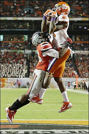 Clemson Tigers wide receiver Martavis Bryant makes a catch for a touchdown as Ohio State cornerback Armani Reeves arrives too late.