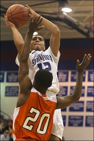 Springfield's Mason Durden puts up two points over Southview's Willie Bankston. Durden had 17 points.
