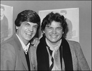 Phil, left, and Don Everly, of the Everly Brothers joke around for photographers in New York City, Jan. 4, 1984.