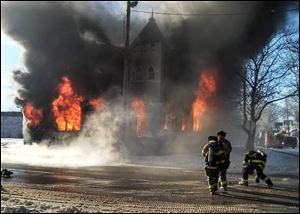 Toledo firefighters battle a fire at Saint Mark Baptist Church in the 1400 block of Fernwood Avenue in Toledo.