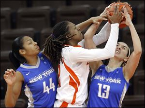 Bowling Green State University forward Alexis Rogers (32) battles Buffalo guard Jenna Rickan (13) and center Christa Baccas (44) for a rebound.