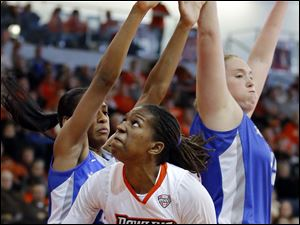 Bowling Green State University forward Alexis Rogers (32) shoots against Buffalo center Christa Baccas (44).