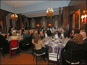 Guests enjoy the dinner and party during the Toledo Club New Year's Eve Gala.