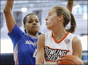 Bowling Green State University guard Miriam Justinger (30) looks for an opening against Buffalo guard Joanna Smith (4).