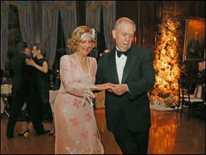 John and Toni Gibson, from Detroit Yacht Club, hit the dance floor during the Toledo Club New Year's Eve Gala.