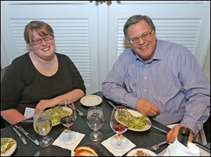 Emily Dye and her father Carson Dye celebrate the coming new year with dinner at Georgio's Cafe International.
