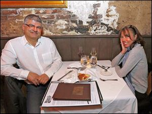 George and Beth Aouad celebrate the coming new year with dinner at Mancy's Steakhouse.