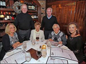 Celebrating the coming new year with dinner at Mancy's Steakhouse are Robert Floyd, back left, and Marty McGowan, back right, with Joanne Floyd, seated left, Barbara and Jim McGowan and Nancy Harshman, seated right.