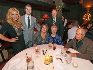 Celebrating the coming new year with dinner at Mancy's Steakhouse are standing from left; Amanda Border, Clay Simpkins and father Bill Simpkins, with seated from left, Bobbie Simpkins and Bea and Fred Tredway. They were also celebrating Mr. Tredway's 89th birthday.