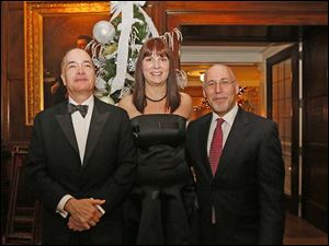 Allan Block, Susan Block, and Mitchell Cantor, right, from NYC,  enjoy the party during the Toledo Club New Year's Eve Gala.