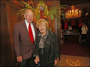 Dr. Milo Danzeisen and his wife Chrissie Danzeisen enjoy cocktail hour during the Toledo Club New Year's Eve Gala.