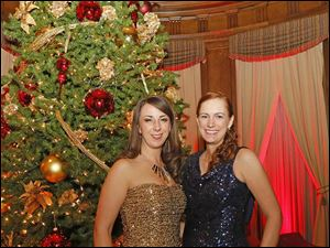 Emilie Vassar, left, and Ashley Mirakian, right, enjoy cocktail hour during the Toledo Club New Year's Eve Gala.