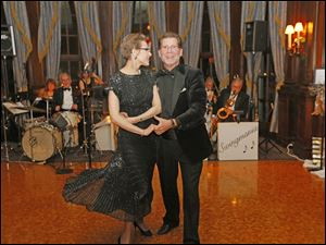 Matthew and Paula Lahti dance and enjoy the party during the Toledo Club New Year's Eve Gala.