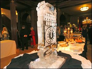 A large ice sculpture decorates the table during cocktail hour at  the Toledo Club New Year's Eve Gala.