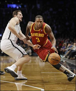The Cavaliers' Dion Waiters drives past Brooklyn's Mirza Teletovic on Saturday night. Waiters led Cleveland with 26 points.