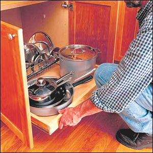 Make the most of your kitchen's existing storage space by installing a pull-out shelf.