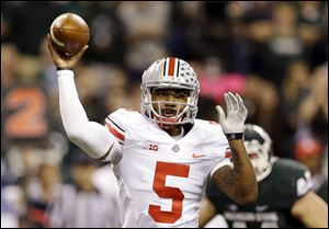 Ohio State's Braxton Miller throws during the first half of a Big Ten Conference championship NCAA college football game against Michigan State, Saturday, Dec. 7, 2013, in Indianapolis.