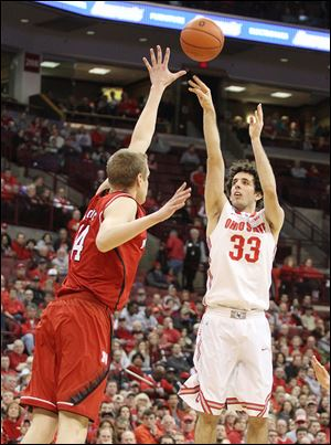 Ohio State's Amedeo Della Valle, who had 15 points, shoots a 3-pointer over Nebraska's Serej Vucetic.