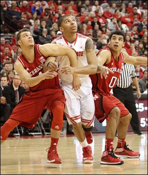 Ohio State's Marc Loving is squeezed in by Nebraska's Nathan Hawkins, left, and Tai Webster. Loving, a St. John's graduate, scored 13 points off the bench.