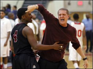 Scott High School player Larry Green celebrates the 3OT win with head coach Chris Dames.