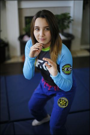 Perrysburg High School student Chloey Sniecinski, 14, has found her passion in jiu jitsu. One day, she would like to open her own gym and teach girls like her how to defend themselves.