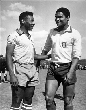 Brazilian footballer Edson Arantes do Nascimento, known as Pele, left, enjoys a chat with Eusebio da Silva Ferreira in Lisbon, Portugal in this 1963 file photo.