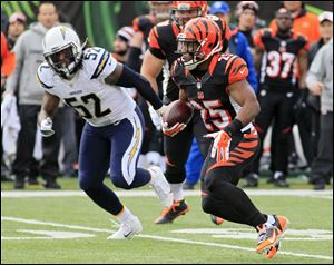 Cincinnati Bengals running back Giovani Bernard runs past San Diego Chargers linebacker Reggie Walker in the first half of an AFC wild-card playoff game.