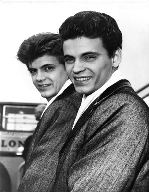 In this April 1, 1960 file photo, Phil, left, and Don of the Everly Brothers arrive at London Airport from New York to begin their European tour.