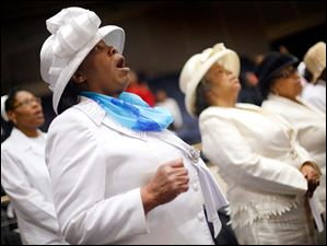 Mildred Gilmore sings with other church mothers as members of St. Mark Baptist Church meet for service.