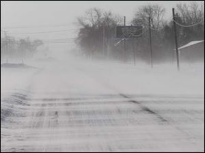 Snow blows over State Rt. 25 south near Haskins.