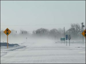 Visibility is reduced along State Rt. 25 at the intersection with State Rt. 582, east of Haskins.