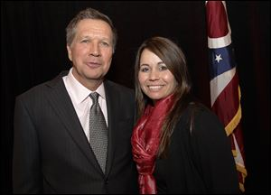 Elizabeth Ranade-Janis, with Ohio Gov. John Kasich after a December Chamber of Commerce meeting, is Ohio's first coordinator against human trafficking.