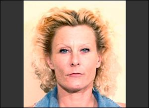This June, 1997 file booking photo provided by the Tom Green County Jail in San Angelo, Texas, shows Colleen R. LaRose, also known as 'Jihad Jane.'