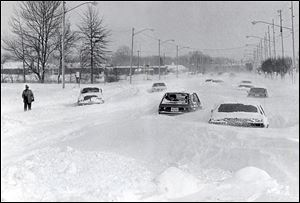 Cars are stranded on Heatherdowns Boulevard on Jan. 27, 1978, after the big blizzard. Some drifts measured up to 15 feet.