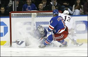 Columbus Blue Jackets' Cam Atkinson (13) scores on New York Rangers goalie Henrik Lundqvist (30) during the second period Monday in New York.