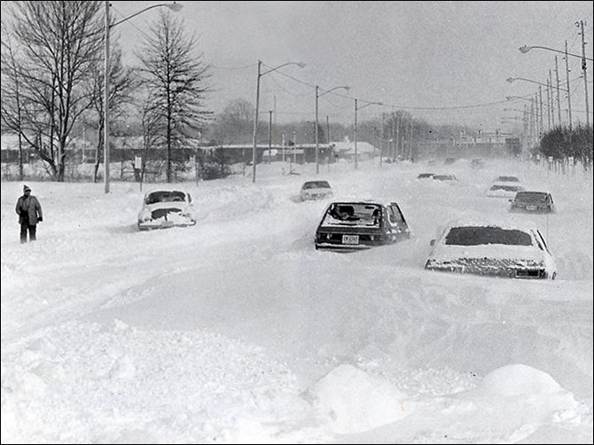 s3blizzard Cars are stranded on Heatherdowns Boulevard on Jan. 27, 1978, after the big blizzard. Some drifts measured up to 15 feet.