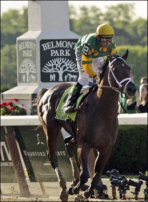 Palace Malice, ridden by jockey Mike Smith, wins the 145th Belmont Stakes horse race at Belmont Park on June 8, 2013, in Elmont, N.Y.