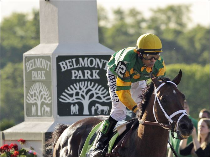 Belmont Stakes Horse Racing Mike Smith Palace Malice, ridden by jockey Mike Smith, wins the 145th Belmont Stakes horse race at Belmont Park on June 8, 2013, in Elmont, N.Y.