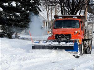 City of Toledo crews plow Olson Street after cars were removed.