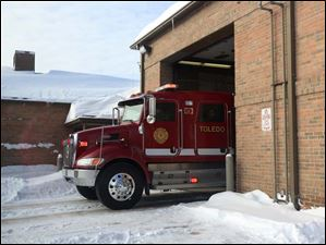 Toledo firefighters respond to a call from an ill person. The unusually cold weather has forced firefighters to contend with calls from people unable to reach hospitals on their own because of snow and made it harder for their trucks to get to people in need.