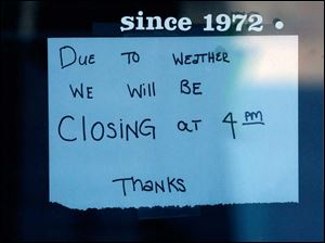 Barry Bagels on Central Avenue uses a paper sign to announced it will be closed during the weather emergency.