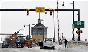 Toledo crews remove snow from the Martin Luther King, Jr., Bridge, which should be helped by a warming pattern in the next few days, according to the National Weather Service. Temperatures may reach into the 40s.