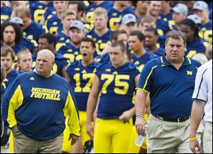 Michigan offensive coordinator Al Borges, left, was relieved of his services. UM averaged 373.5 yards per game, 10th in the Big Ten.
