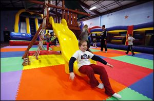 Connor Radkov, 9, slides to the bottom on Sylvania Playland gym equipment on Centennial Road. The third grader was enjoying another day off from Stranahan Elementary School.