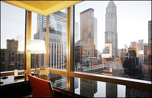 A room on the 30th floor of the Courtyard-Residence Inn Central Park, overlooks midtown Manhattan, Wednesday in New York.