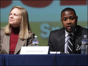 Susan Brown of Bowling Green State University, left, listens as Ashland University student Jonathan Locust speaks.