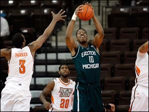 EMU center Da'Shonte Riley (10) pulls in a rebound against Bowling Green defenders Spencer Parker (3), Jehvon Clarke (20), and Cameron Black (35).